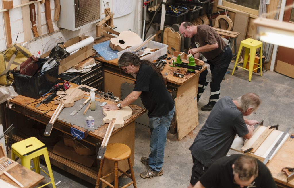 Students working on their guitars in the workshop